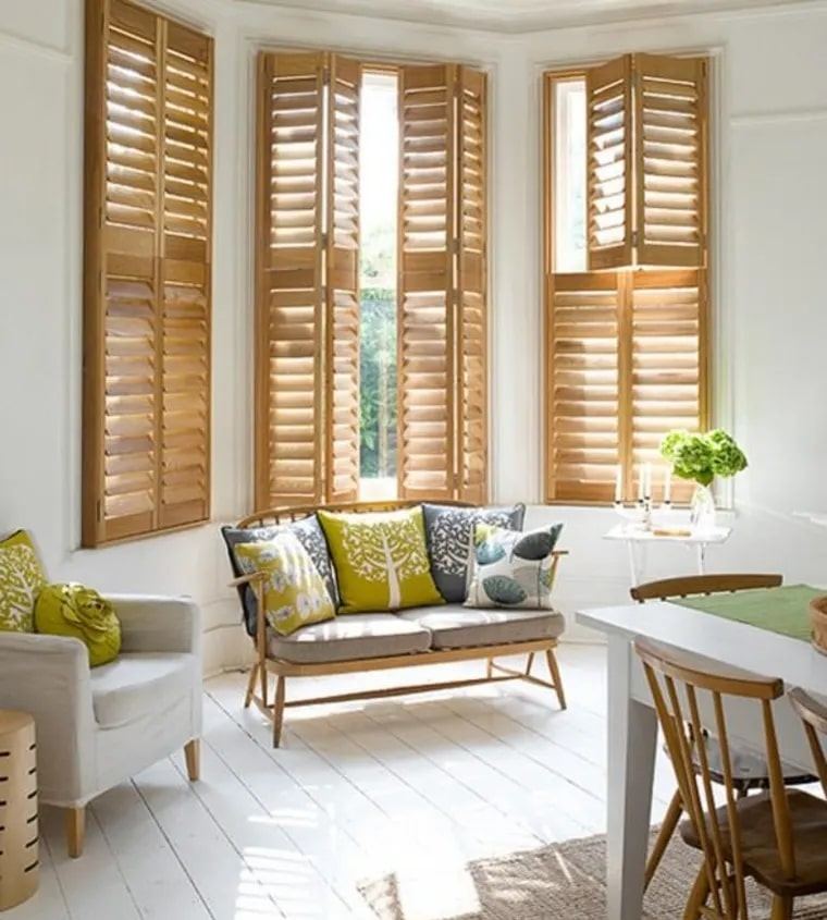 Natural wood finish on interior residential plantation shutters