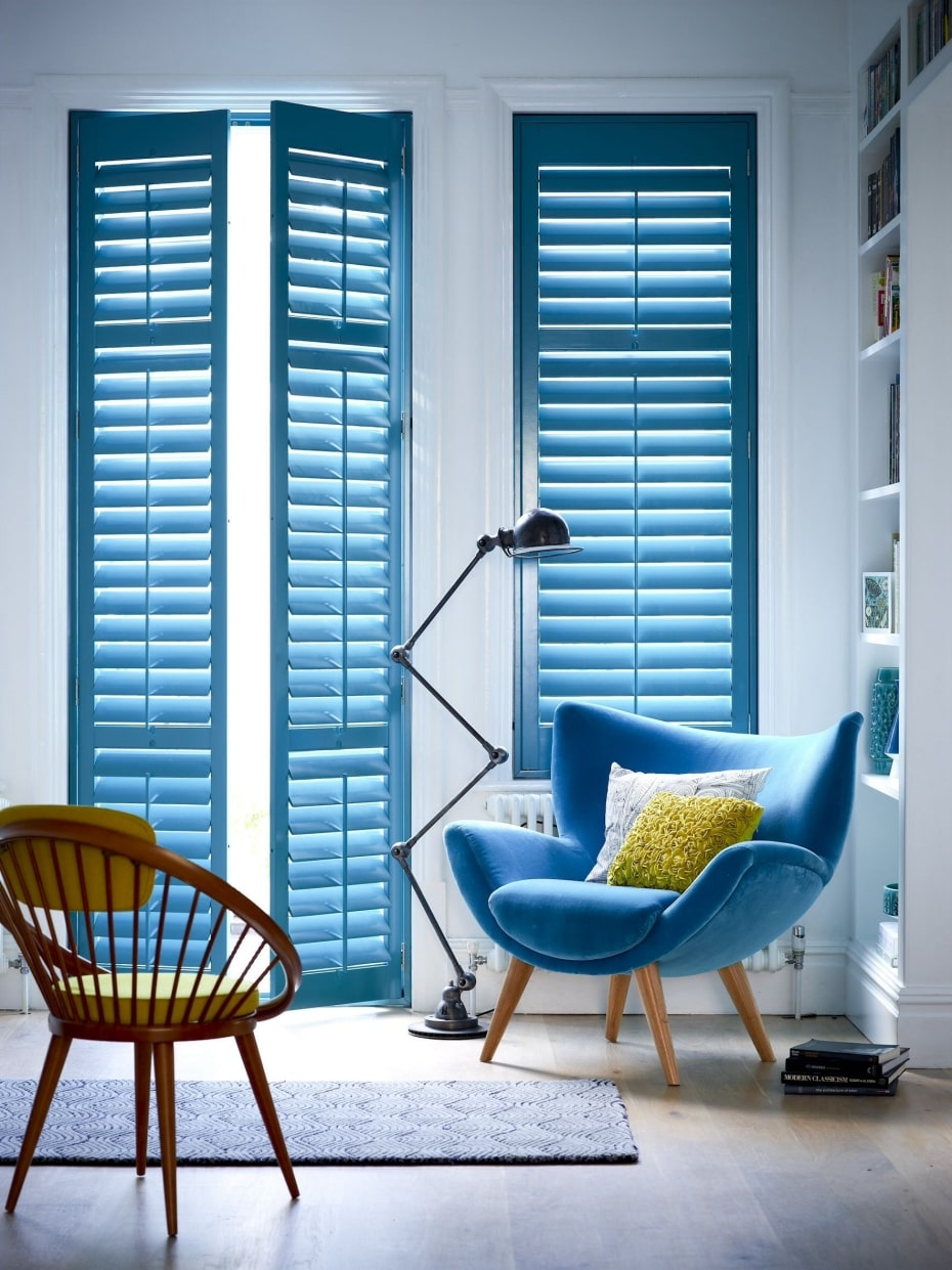 Plantation shutters painted blue with interior design