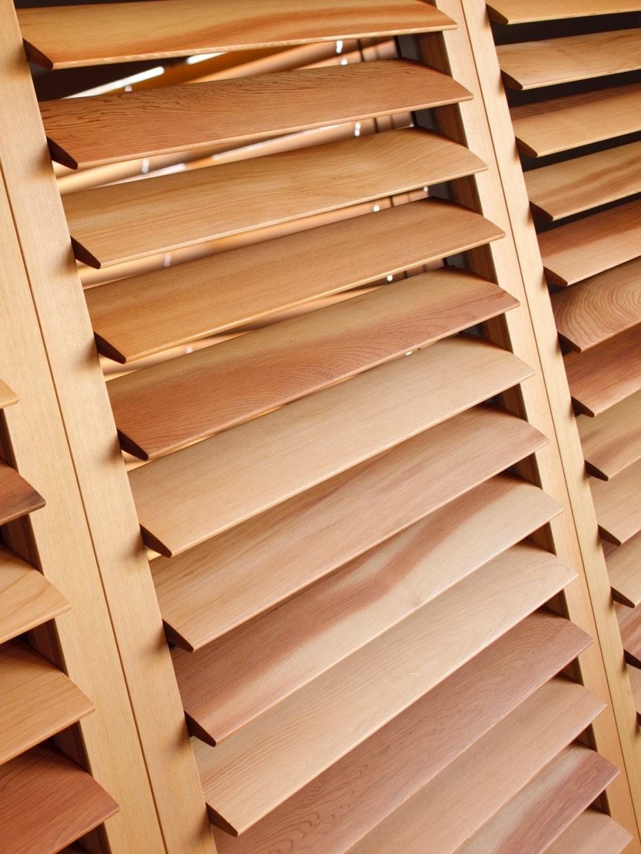 Natural wood plantation shutters